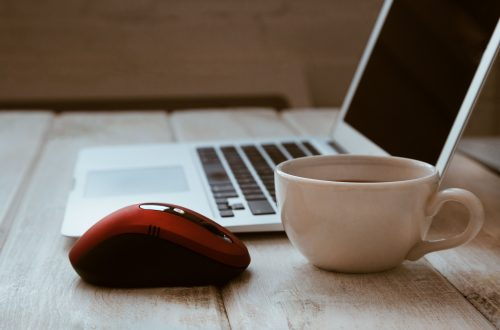 stock photo of a computer with a red mouse ad white coffee cup