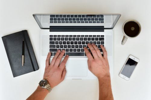stock photo of hands on a portable computer keyboard